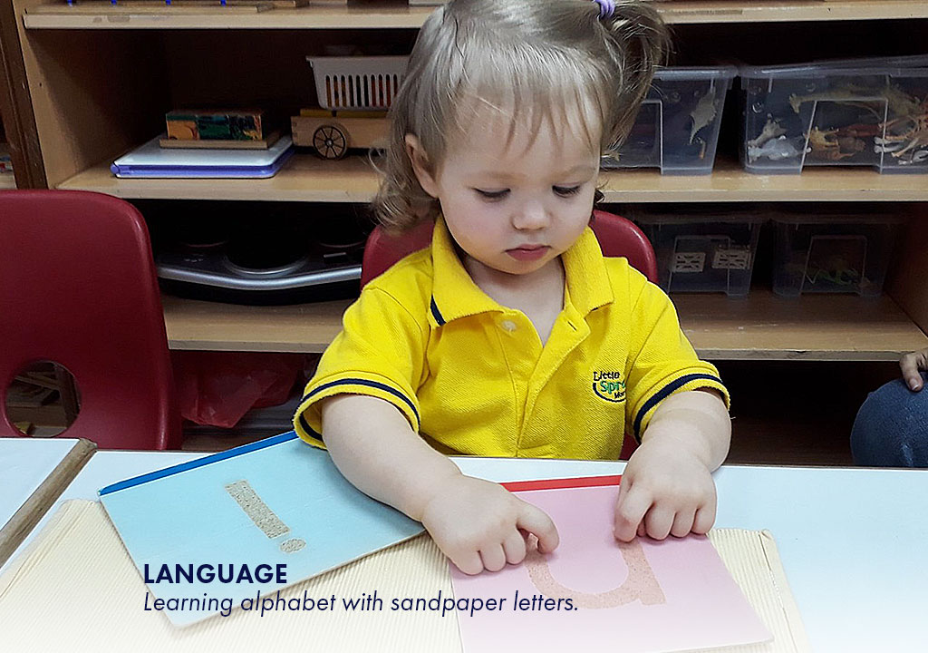 Language - Learning alphabet with sandpaper letters.